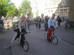 Business people scooting in Amsterdam