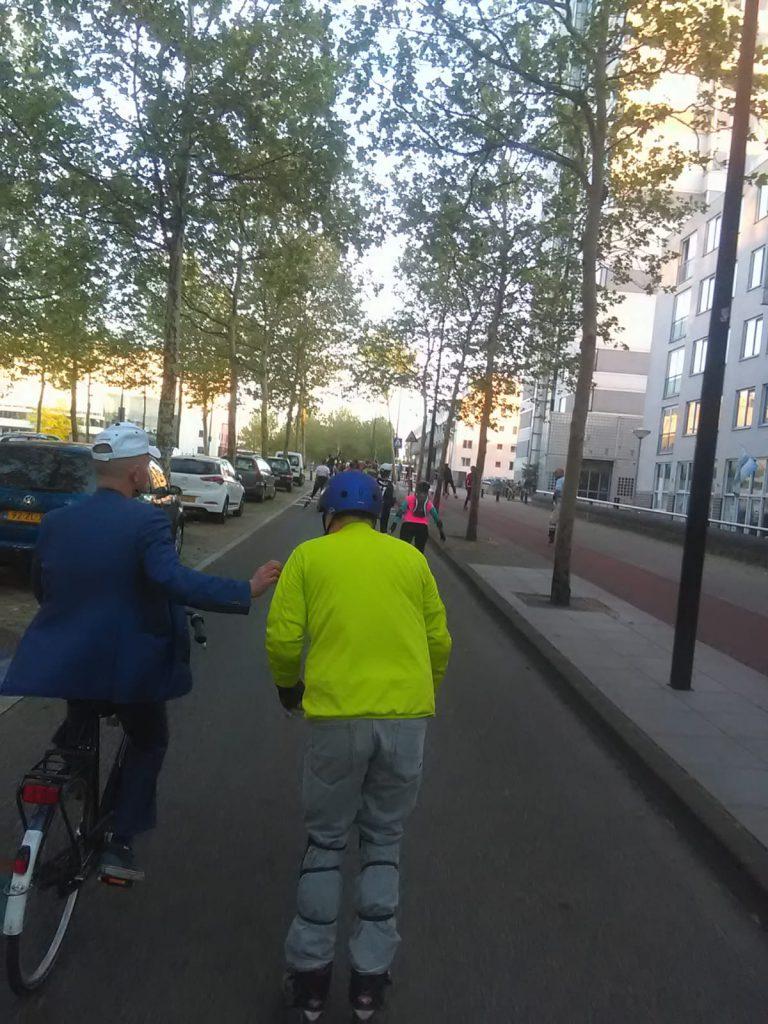 Sporty hidden gem guide of Amsterdam East Lex van Buuren on his bike during Friday Night Skate