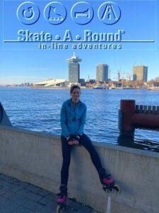 Hidden gems of Amsterdam skate tour with Helma de Bruin on skates facing AMS Adam Tower and EYE filmmuseum