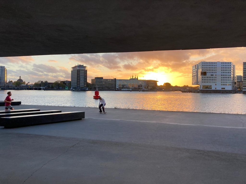 Private inline skating lessons from Skate-A-Round in Amsterdam next to river IJ in autumn and winter time - Rollerblading workshop under the roof of EYE Fillmmuseum
